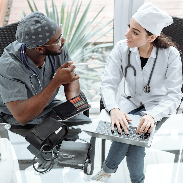 Two healthcare workers talking