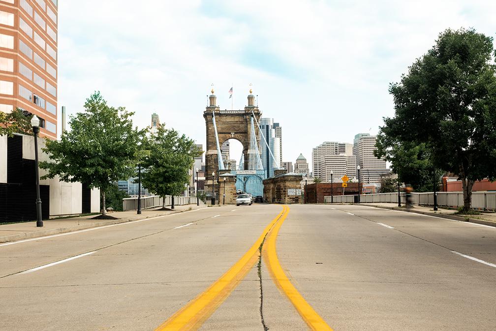 A 4 lane road heading towards the Brooklyn Bridge