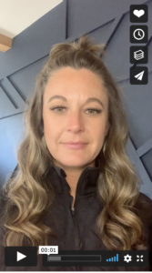 Screenshot of a woman about to speak in a video